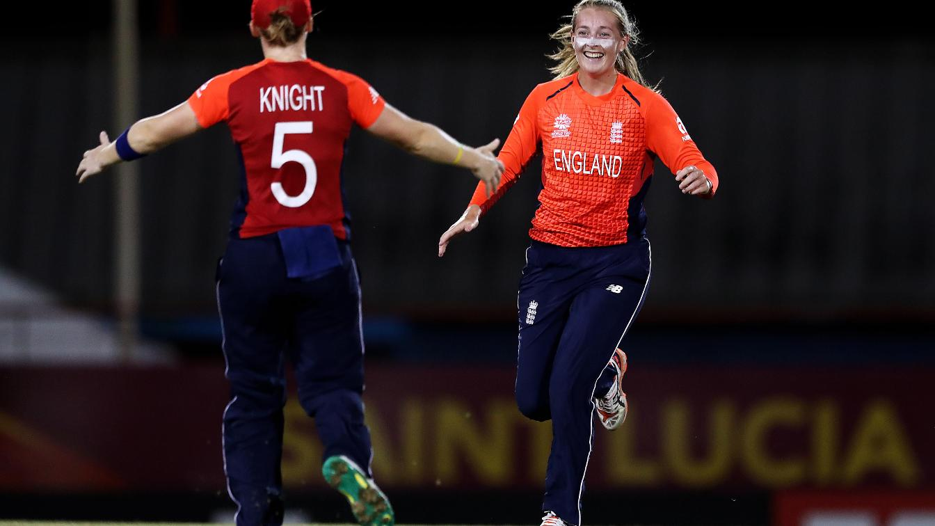 Sophie Ecclestone celebrates with Heather Knight
