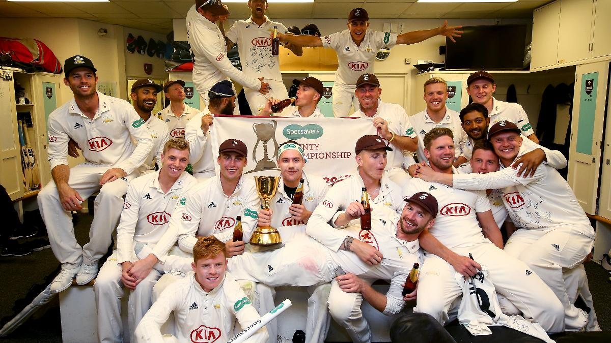 Surrey Captain Rory Burns (C) celebrates with his teammates after winning the Specsavers County Championship