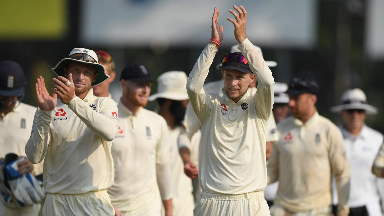 Joe Root and Jos Buttler celebrate victory in Sri Lanka