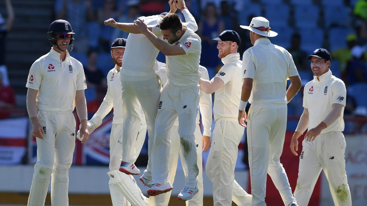 Mark Wood and his teammates celebrate a wicket during his incredible spell in St Lucia