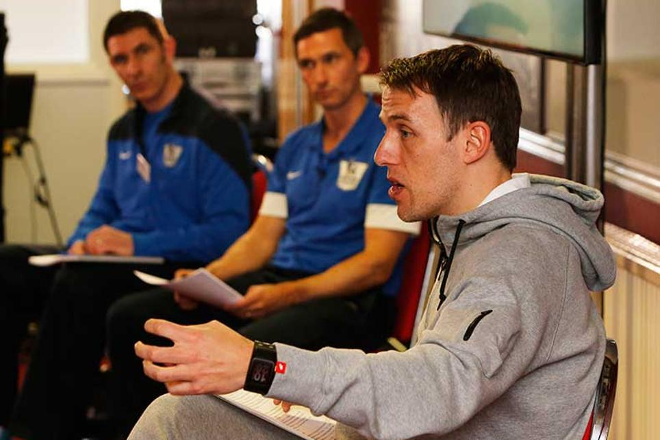 Phil Neville speaks to the academy coaches at The Cliff