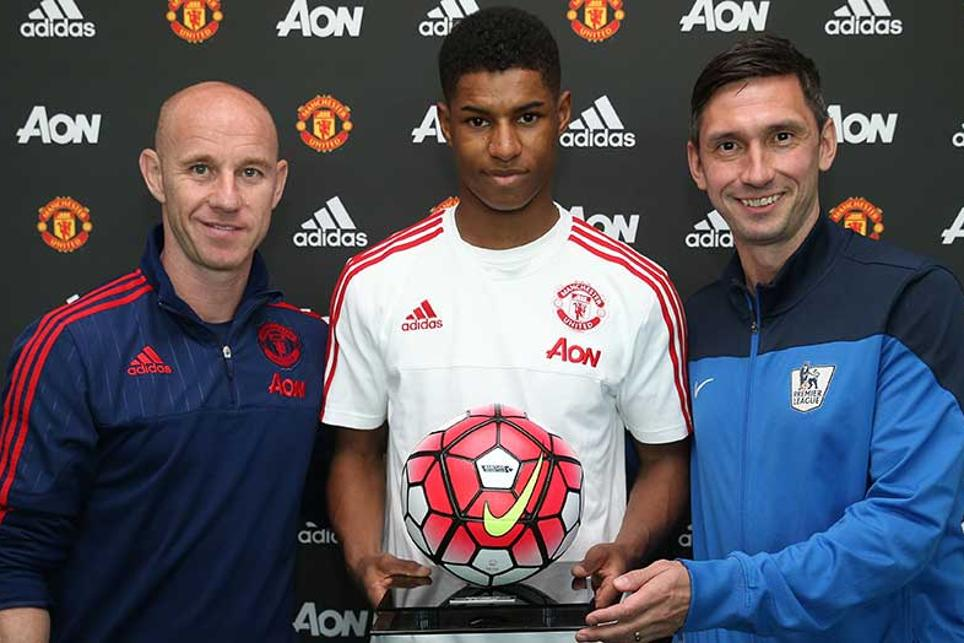 Marcus Rashford got his debut ball from Nicky Butt and the League's Chris Casper
