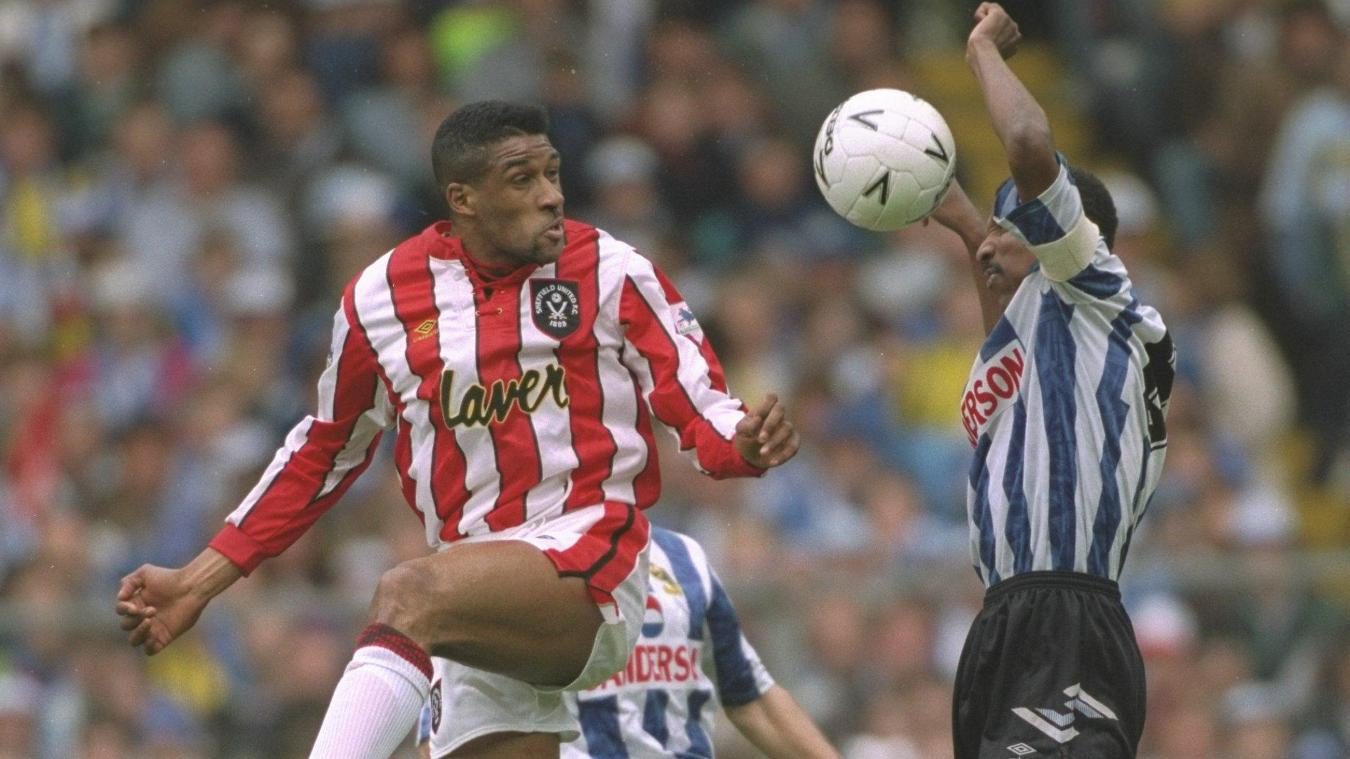 Brian Deane in action against PL and local rivals Sheffield Wednesday