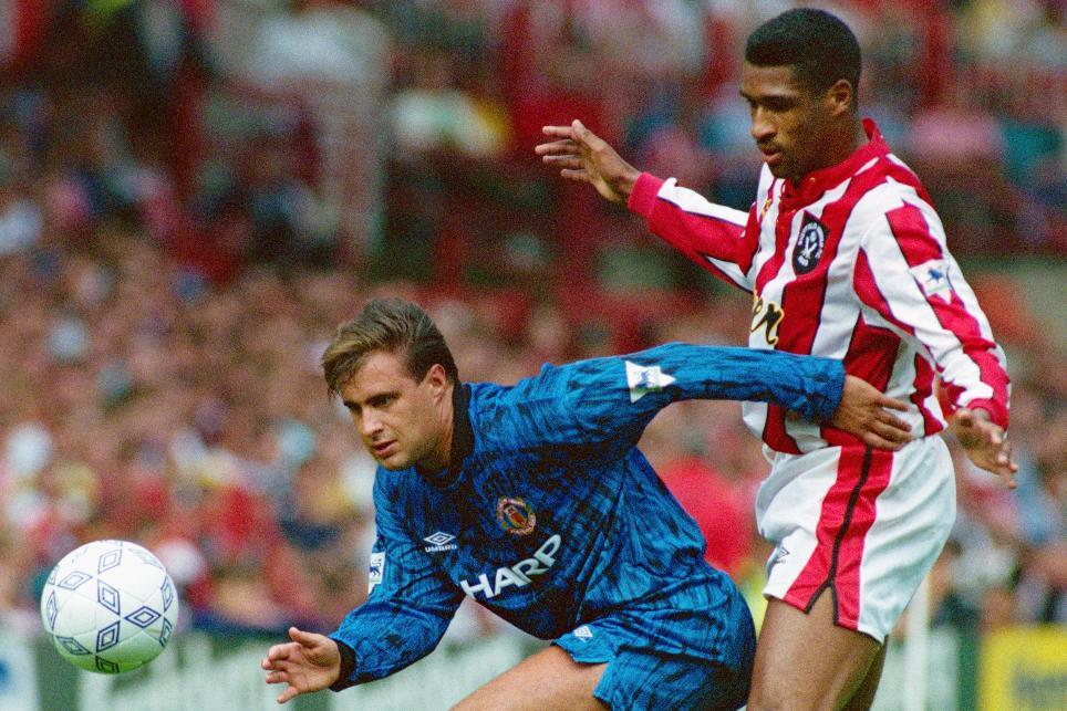 Brian Deane puts Man Utd's Clayton Blackmore under pressure