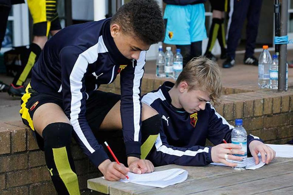 Young players assess their performance during a bio-banding tournament