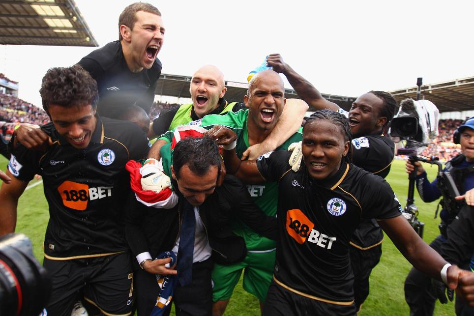 James McArthur (top left) joins the celebrations as Wigan stay up