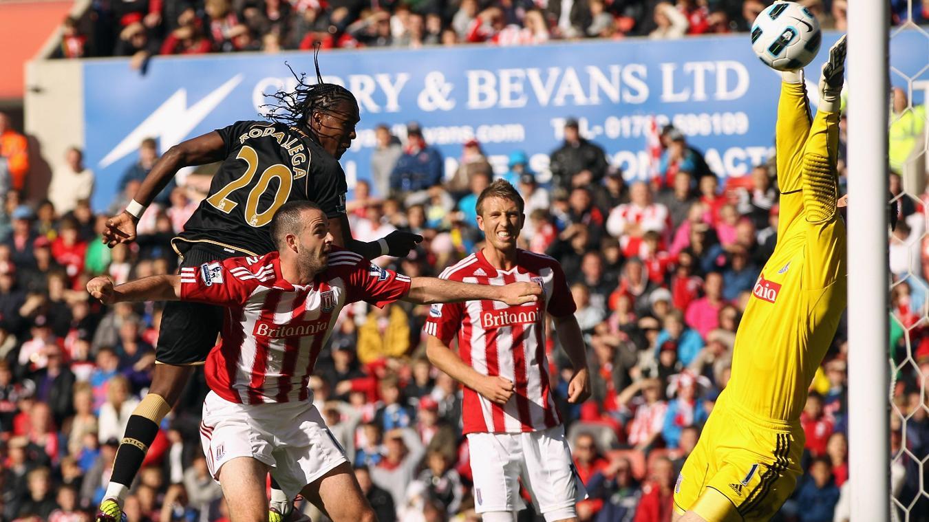 Hugo Rodallega heads in Wigan's final-day winner at Stoke