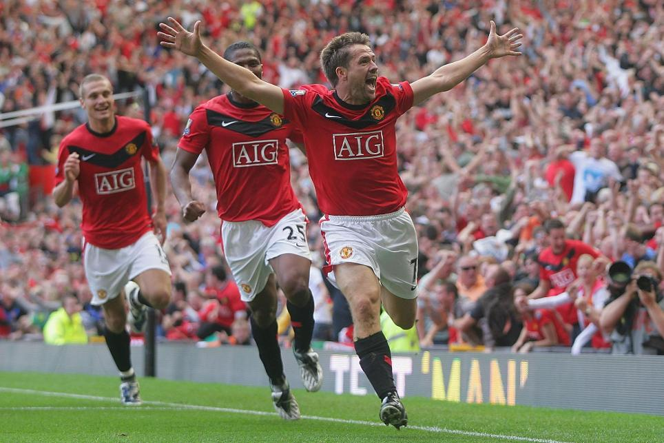 Michael Owen celebrates his last-gap winner in the Manchester derby