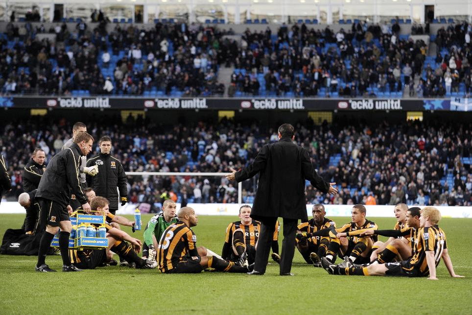 Phil Brown's half-time team talk on the pitch at Manchester City