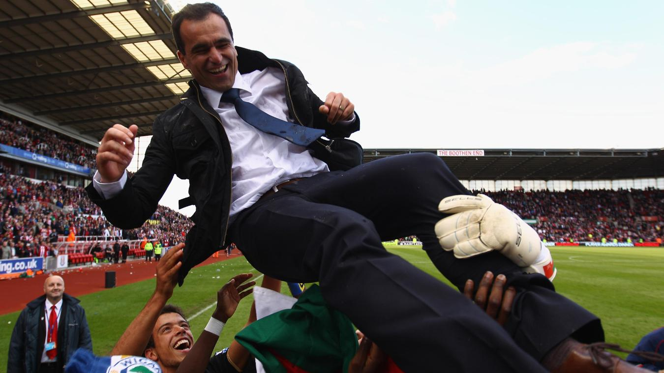 Roberto Martinez is thrown in the air as the Wigan players celebrate