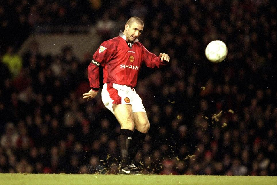 Eric Cantona in action for Manchester United