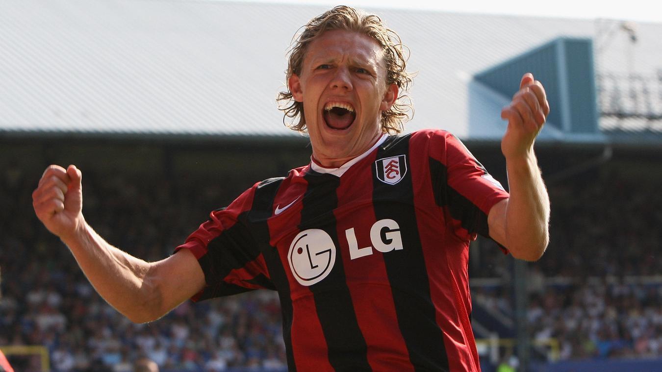 Jimmy Bullard celebrates Danny Murphy's crucial winner at Portsmouth