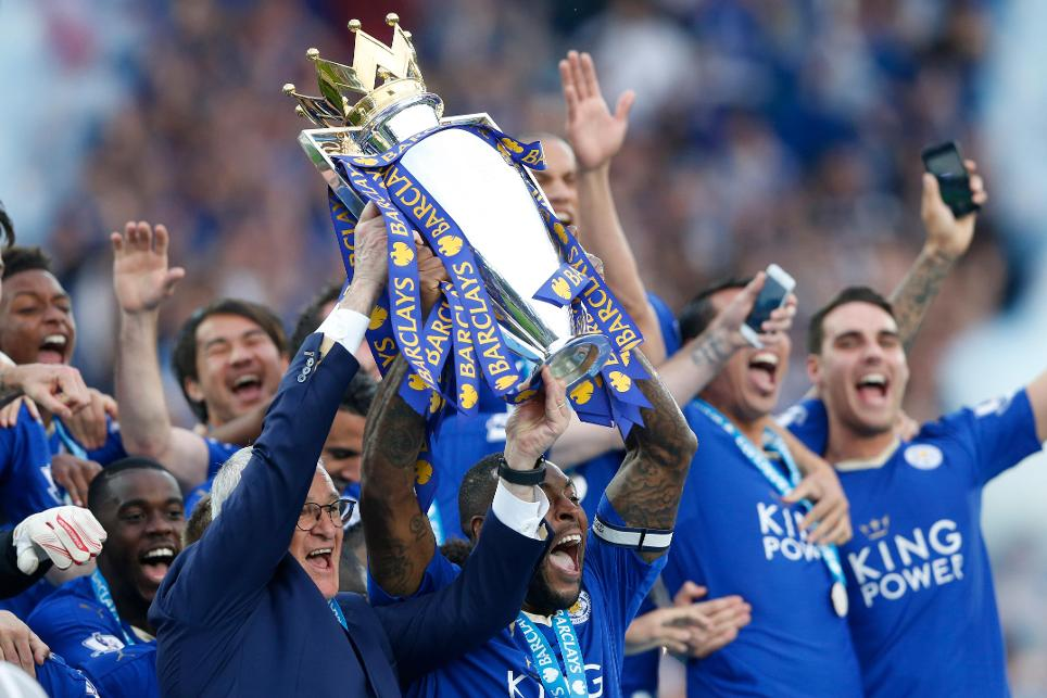 Leicester manager Claudio Ranieri and captain Wes Morgan lift the PL trophy